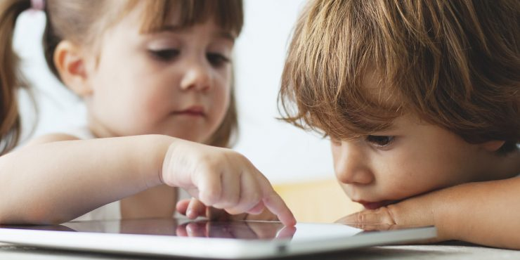 little kids playing tablet