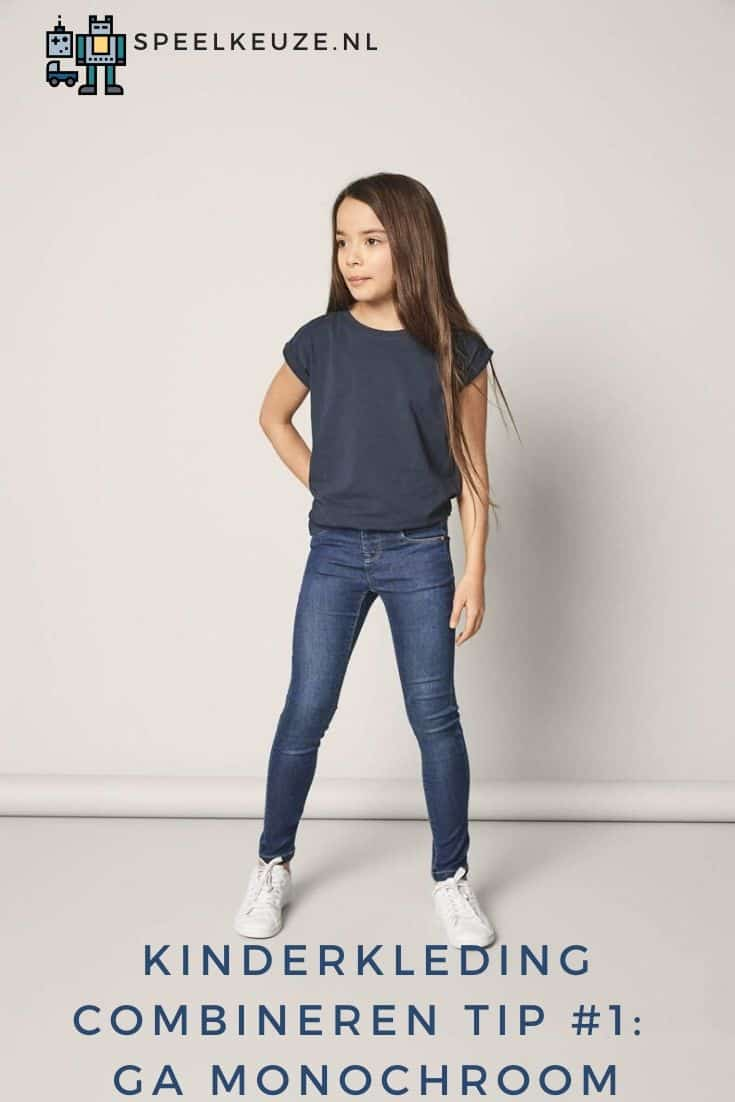 Girl in monochrome blue children's clothing outfit