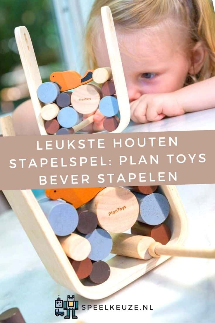 Photo of girl who is concentrated playing the Plan Toys beaver wooden stacking game