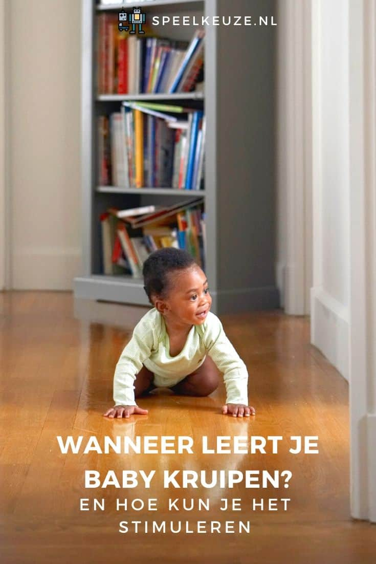 Baby learns to crawl on a wooden floor in the hallway