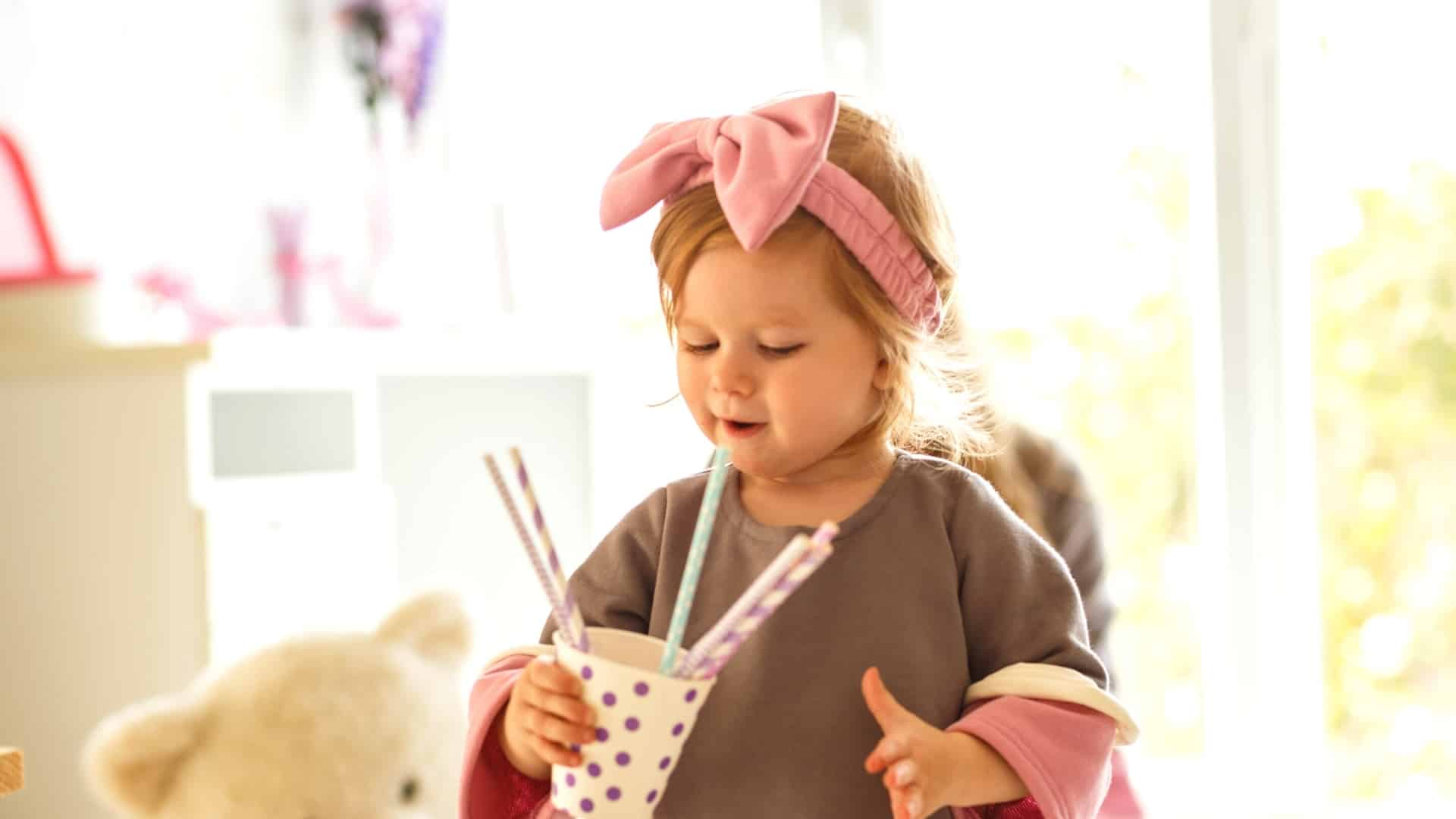 When can a child drink through a straw?