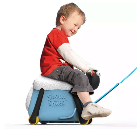2-year-old boy is pulled along on Shaun the Sheep child's suitcase