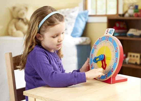Girl practices with Melissa & Doug Turn & Tell Clock