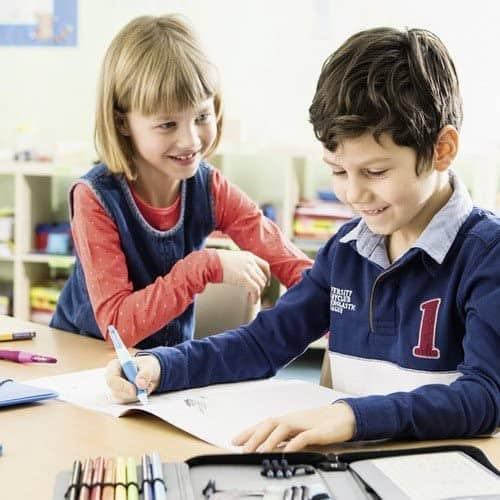 Little boy learns to write with the Stabilo Easy Start pen for right-handed people