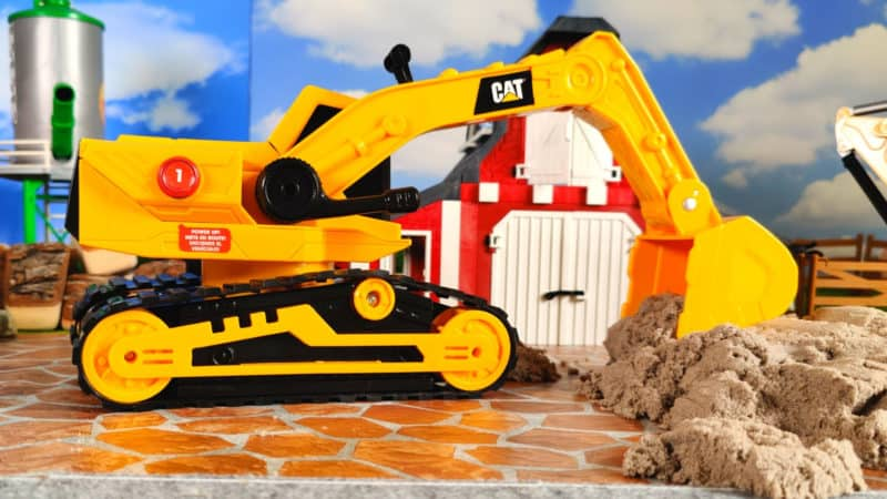 Cat Construction Power Haulers digs in kinetic sand