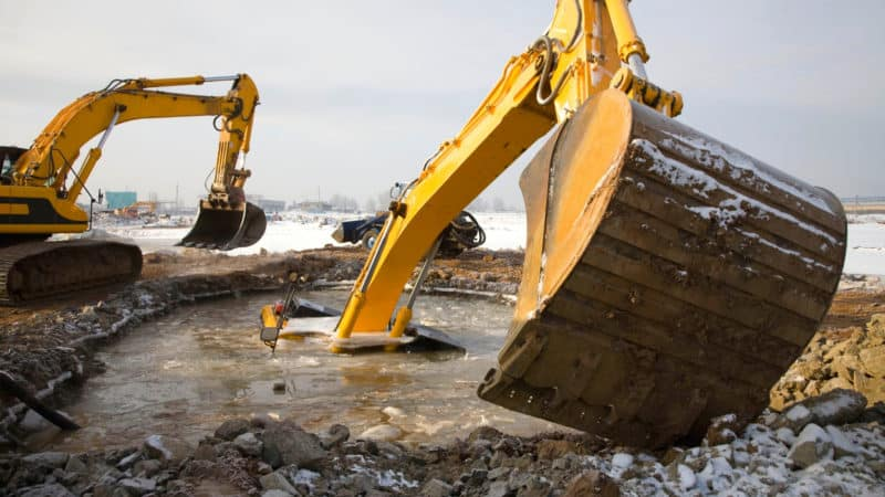 Excavator sinks into the mud